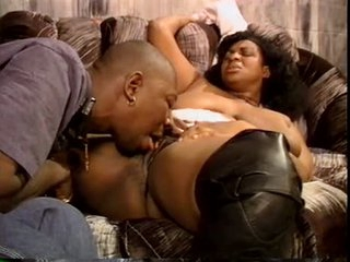 Simmering black BBW chick wide leather boots blowjob